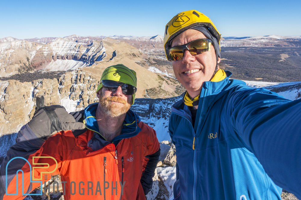 Matt Tuttle and Nathan Smith on the summit of Ostler peak after the first ascent of Siren Song WI4 M4 1600'