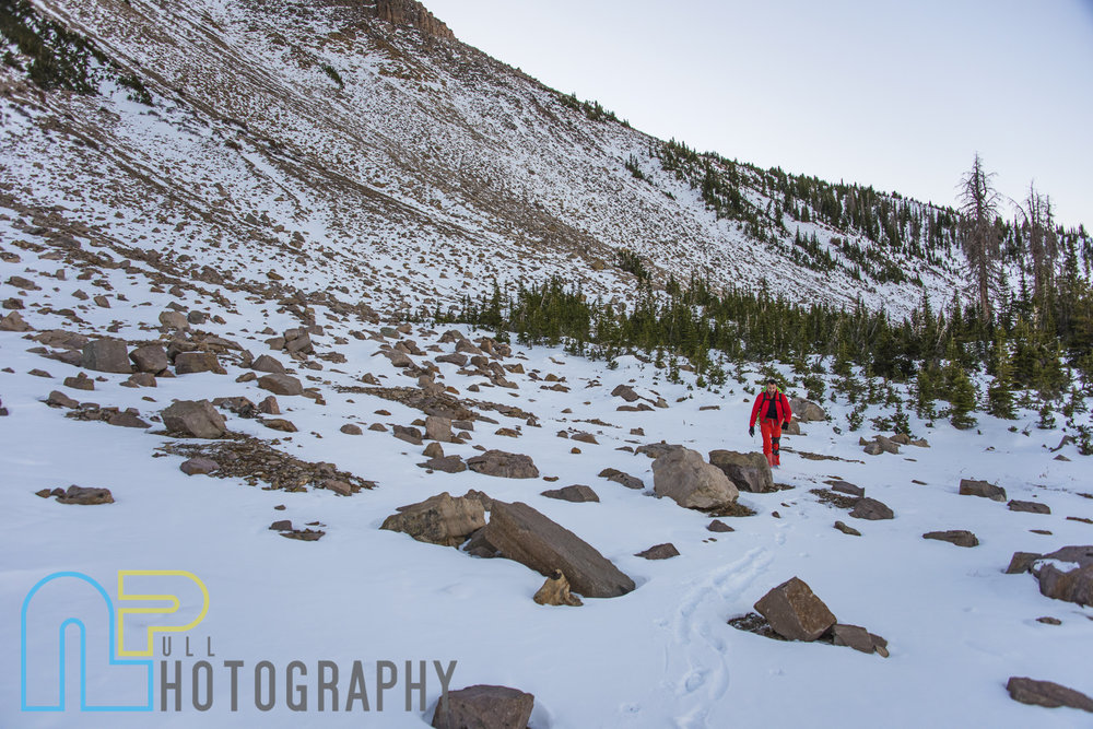 Julien Baudrand hiking along the base of Hayden.
