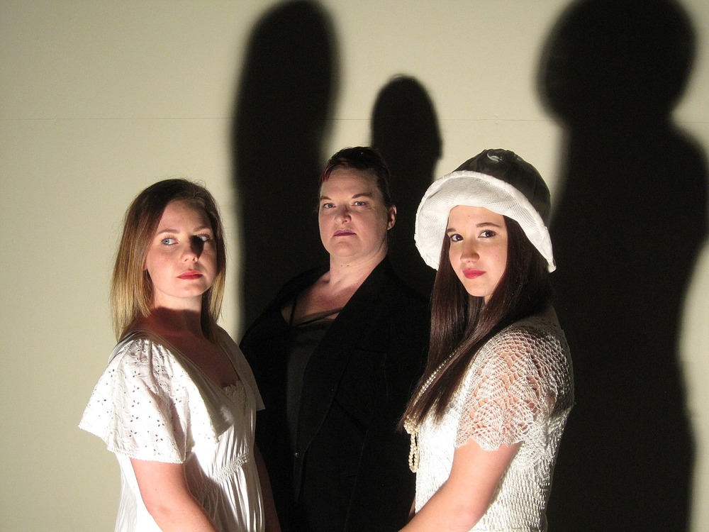 The Cat and the Canary  features Samantha Hutchins, left, as Annabelle West, Kristen Twynam-Perkins as Susan Sillsby and Kelsie Anderson as Cicily Young.