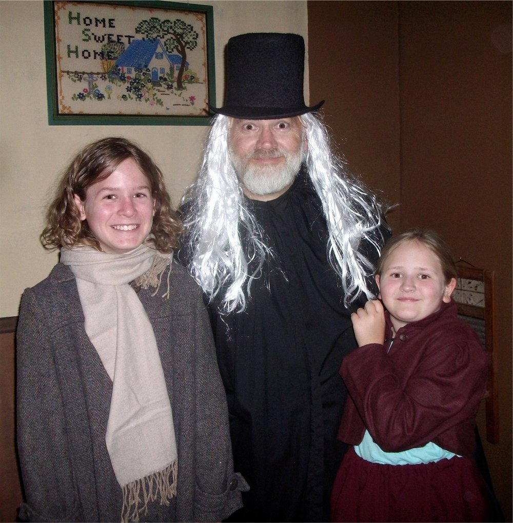 Grant Malcolm, centre, plays Marley's Ghost and is appearing with his children Felix, left, and Eliza in Scrooge