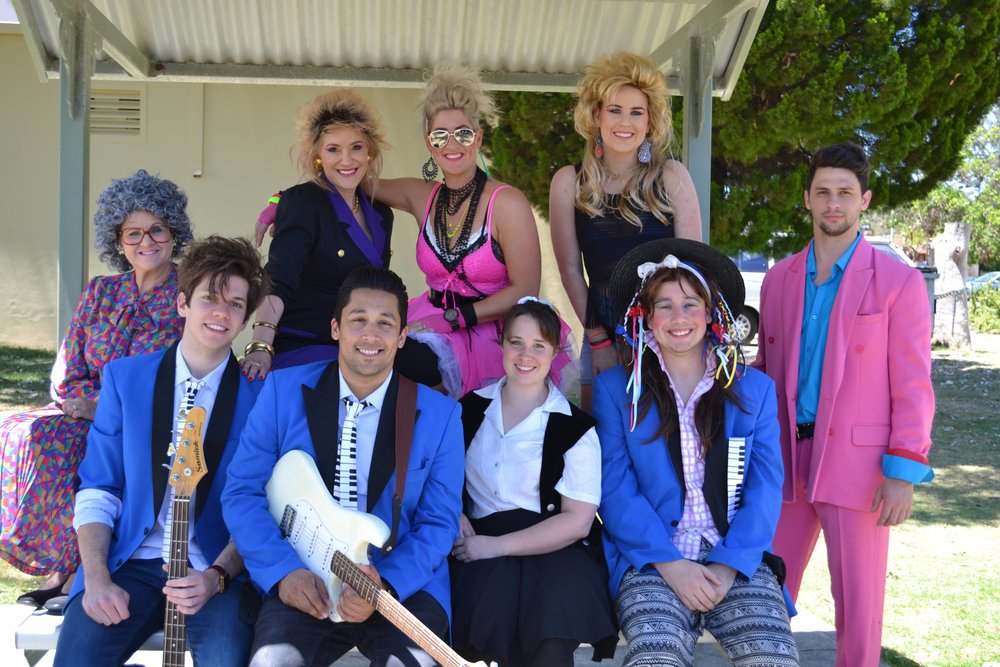The cast of  The Wedding Singer  features Helen Carey, Mirella Renel, Dixie Johnstone, Maggie Clark and Daniel Moxham, at back, and Emerson Brophy, Jared Herft, Steph Hickey and Oliver Kaiser, at front. Picture: Gillian Binks