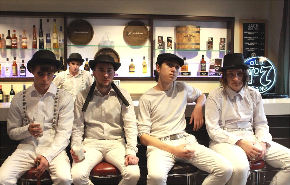 The droogs Alex (Connor Carlyle, left), Dim (Charlie Young), Gerogie (David Heder) and Peter (Josh Harrris) with Sarah Christiner (at back, second from left) as adult Alex. Picture: Blake Hughes