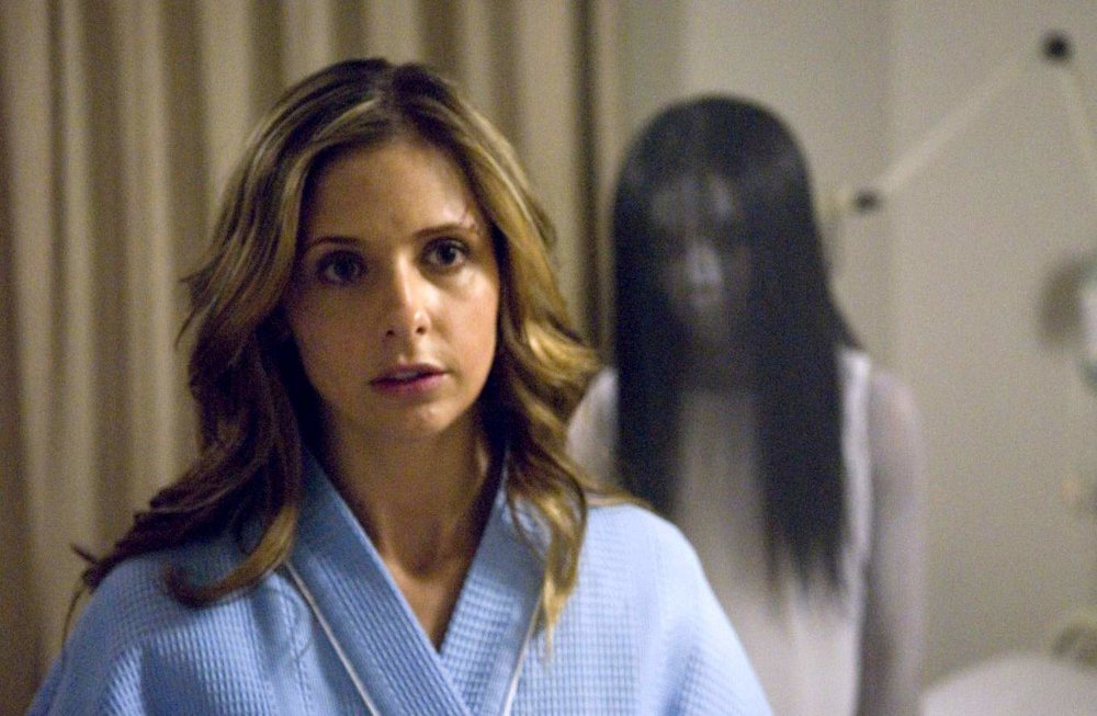 sarah-michelle-gellar-through-the-years-getting-creepy-in-the-grudge.jpg