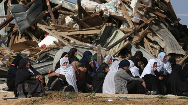 Bedouin women react to the destruction of houses on January 18, 2017, in the unrecognized Bedouin village of Umm al-Hiran in the Negev desert. (AFP Photo/Menahem Kahana)