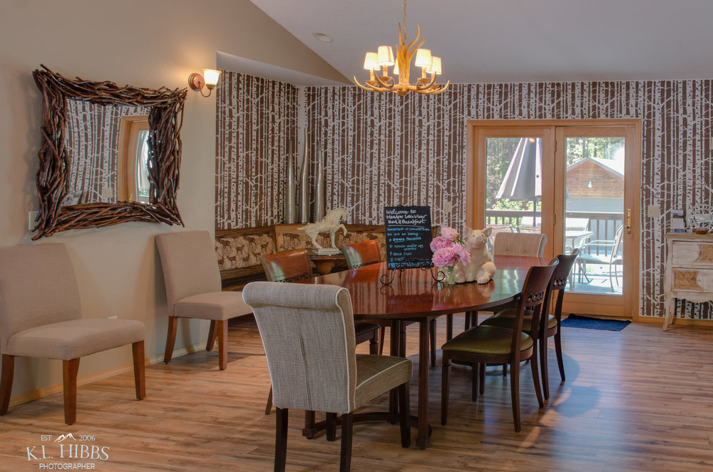 ENJOY YOUR BREAKFAST EACH MORING IN OUR DINING ROOM WITH VIEWS OF THE SURROUNDING FOREST.