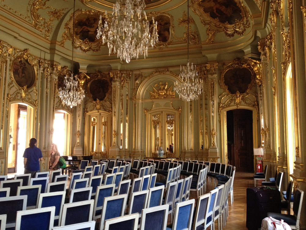 Setting up the Ballroom for the Afternoon Concert. The chair's were so old! Some had fleas!