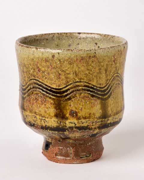 Jim-Malone_Combed-Yunomi_with-river-iron-granite-and-ash-glazes.jpg