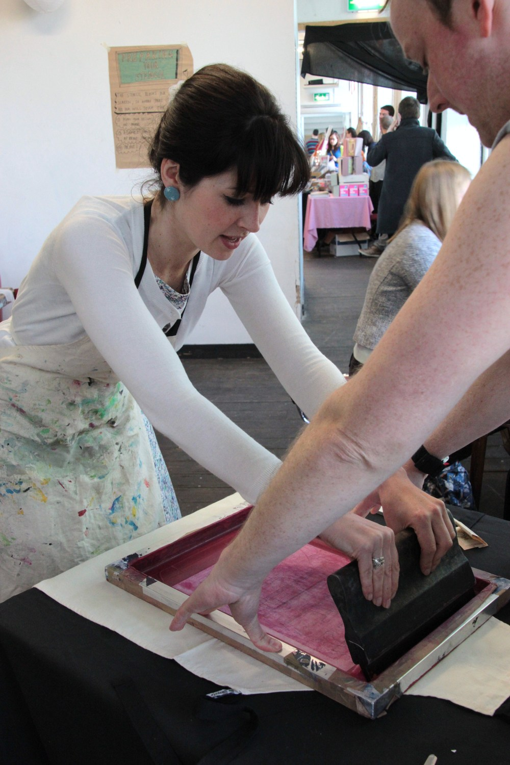 Lisa Comfort  has a go at Mr Wingate's screen printing workshop.