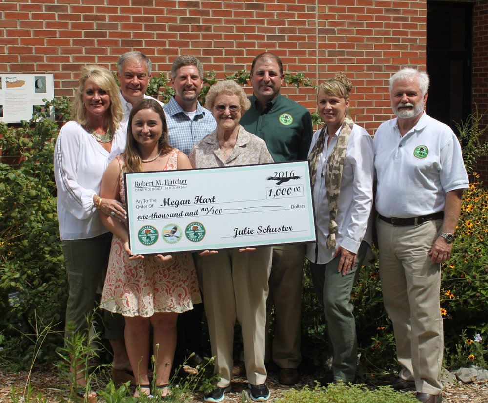 To Megan's right is Mr. Hatcher's wife, Betty. Also pictured from left are the Hatchers' daughter, Terri Hatcher Goodwin, TWRA Executive Director Ed Carter, the Hatchers' son, Jerry, TWRA Bird Conservation Coordinator, David Hanni, Tennessee Wildlife Resources Foundation Executive Director, Julie Schuster, and TWRA Biodiversity Division Chief, Bill Reeves. The presentation was made on the campus of Austin Peay State University in Clarksville.