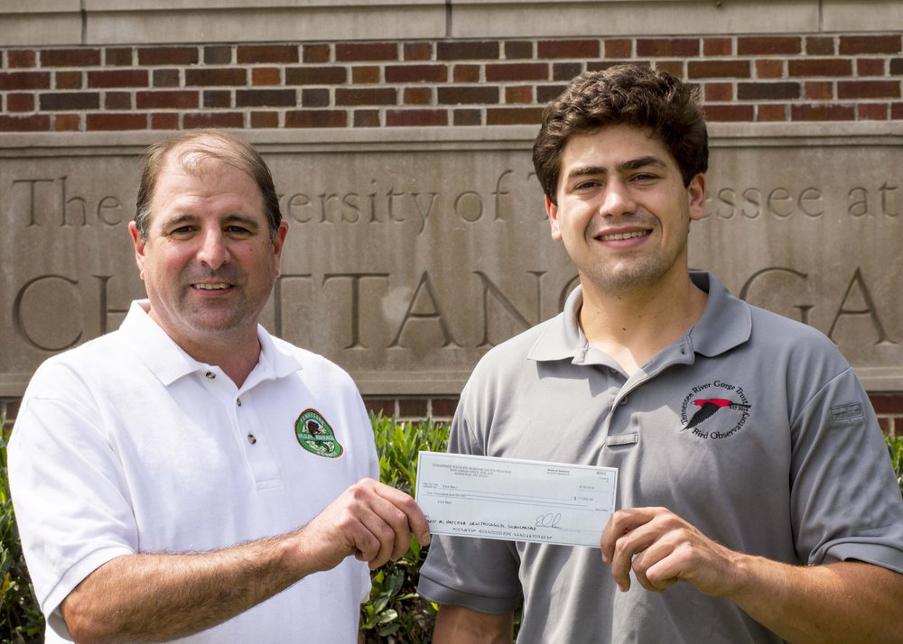 TWRA Bird Conservation Coordinator, David Hanni, presents Eliot his scholarship check on the campus of University of Tennessee at Chattanooga.