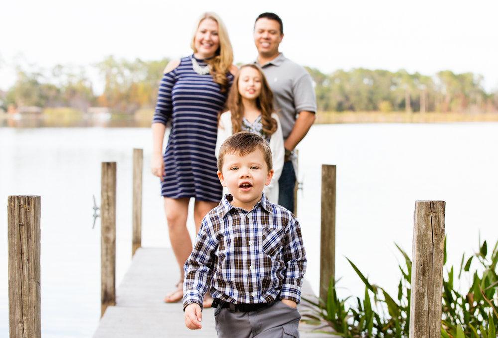 smiling-happy-family-portrait-young-boy-lake-dock.jpg