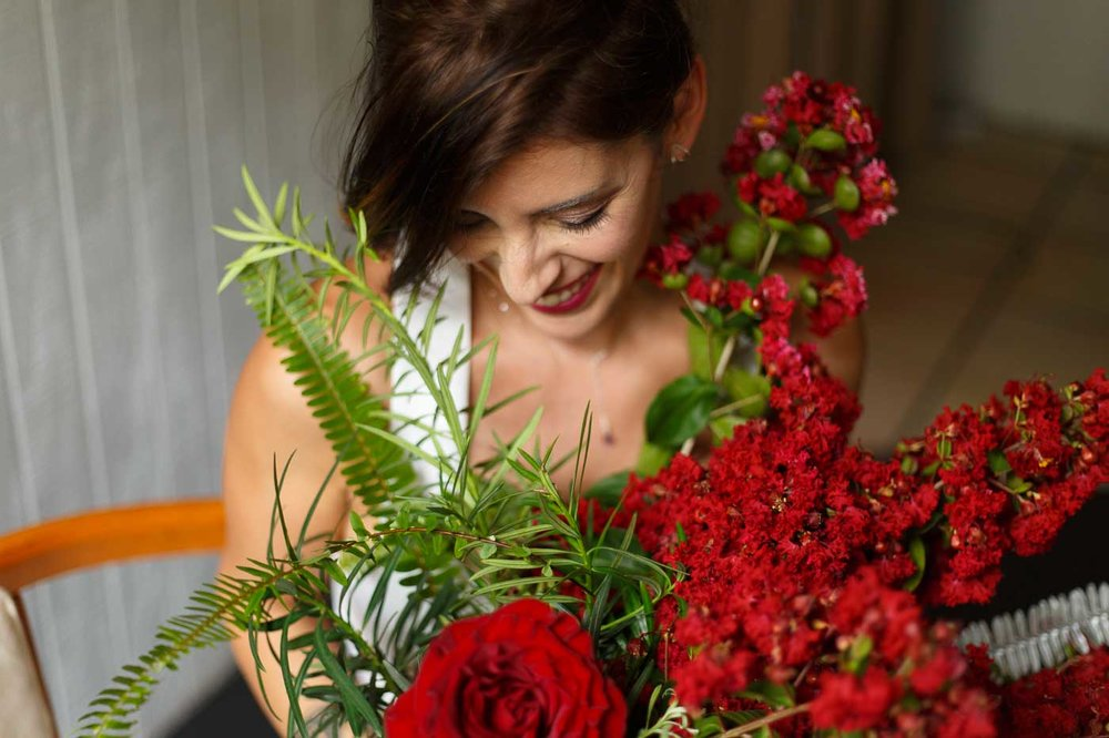bridal-portrait-red-flowers-smiling-bride-winter-park.jpg