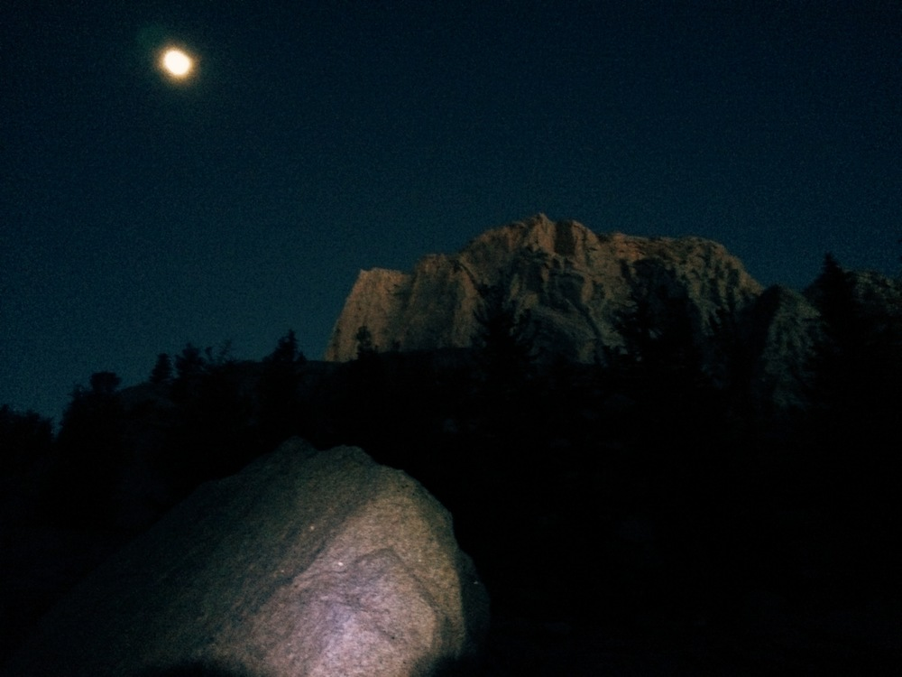 The moon was still high up in the sky as the first hints of sunlight began to illuminate the mountains.