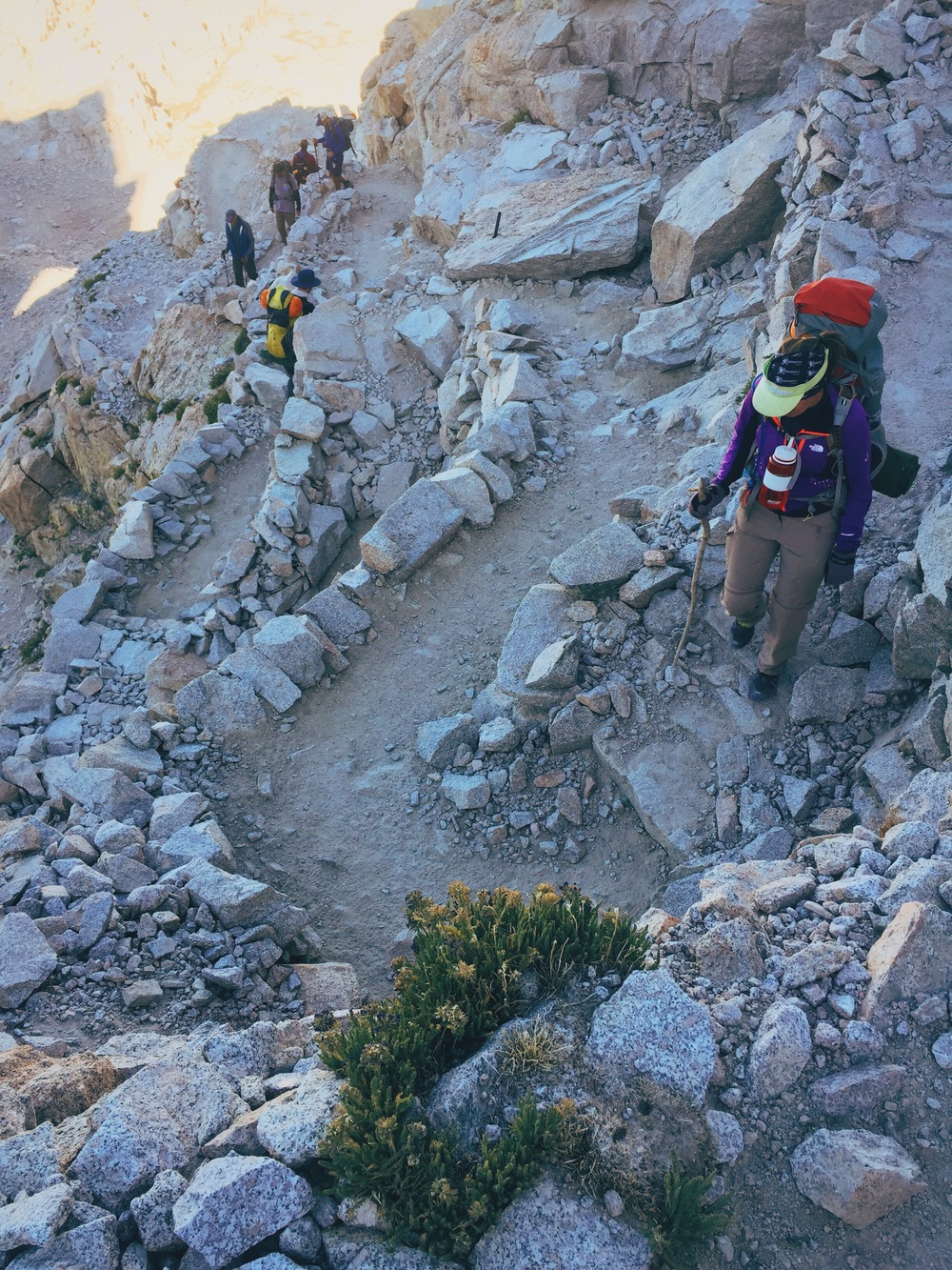 "A section of the notorious ""99 switchbacks"" on the trail toward Whitney Portal. Genevieve was teaching us to count to 99 in French."