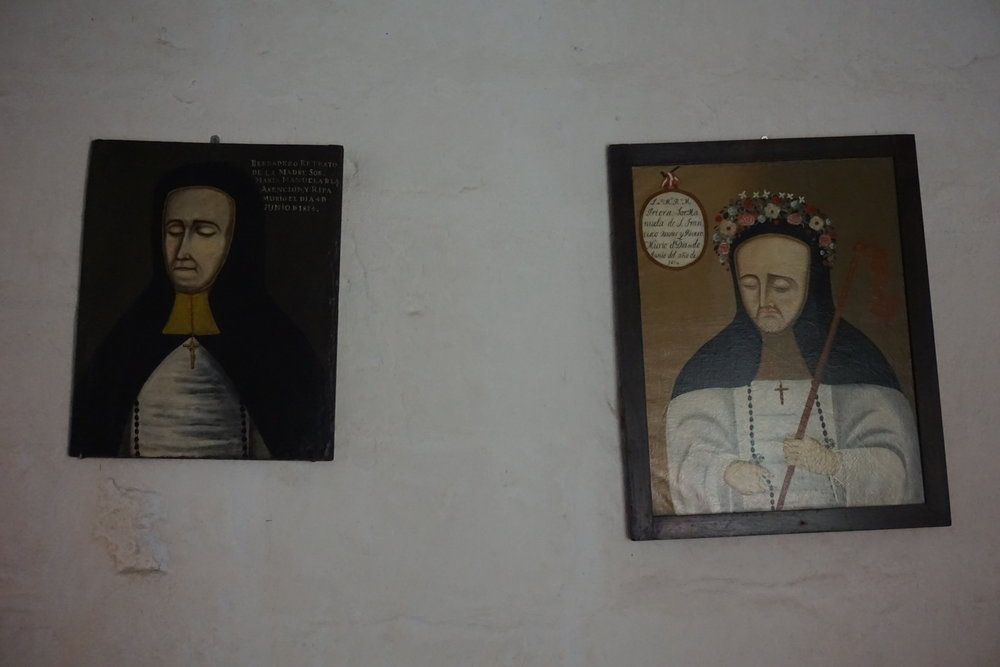 Portraits of deceased nuns who lived and died in the Monasterio de Santa Catalina hang in a hall where their bodies were placed for a period of mourning