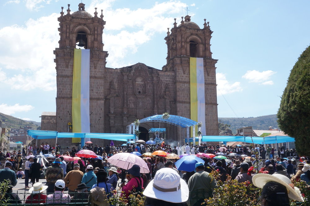 The celebration for the Fiesta de la Virgen de Candelaria getting underway at the central plaza of Puno, near the shore of Lake Titicaca.