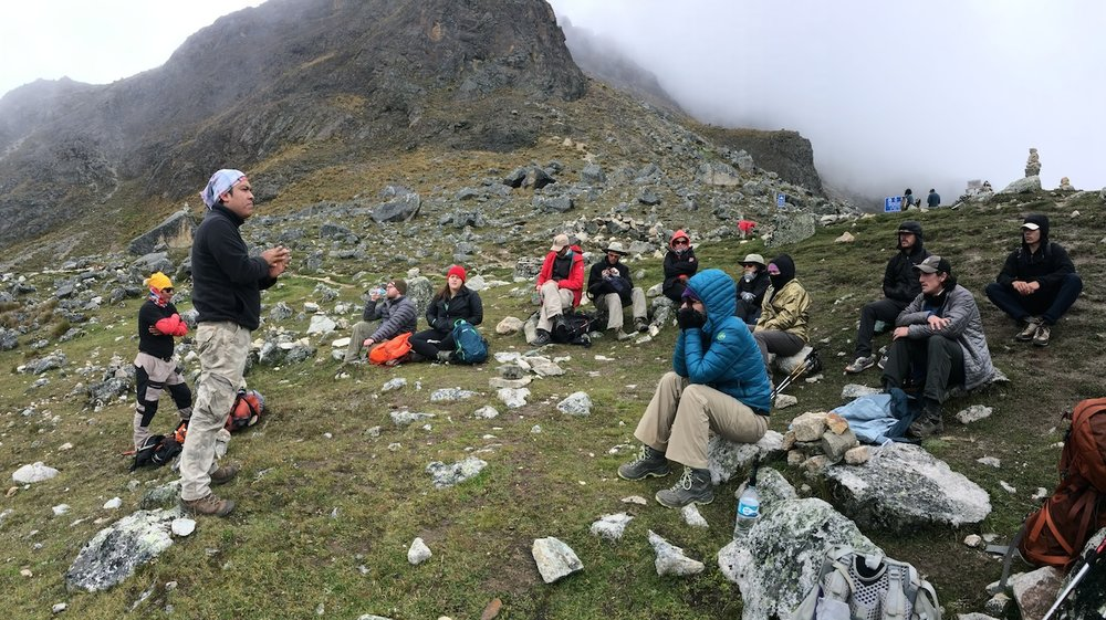 Our guide sharing knowledge with our weary group at Salkantay Pass.
