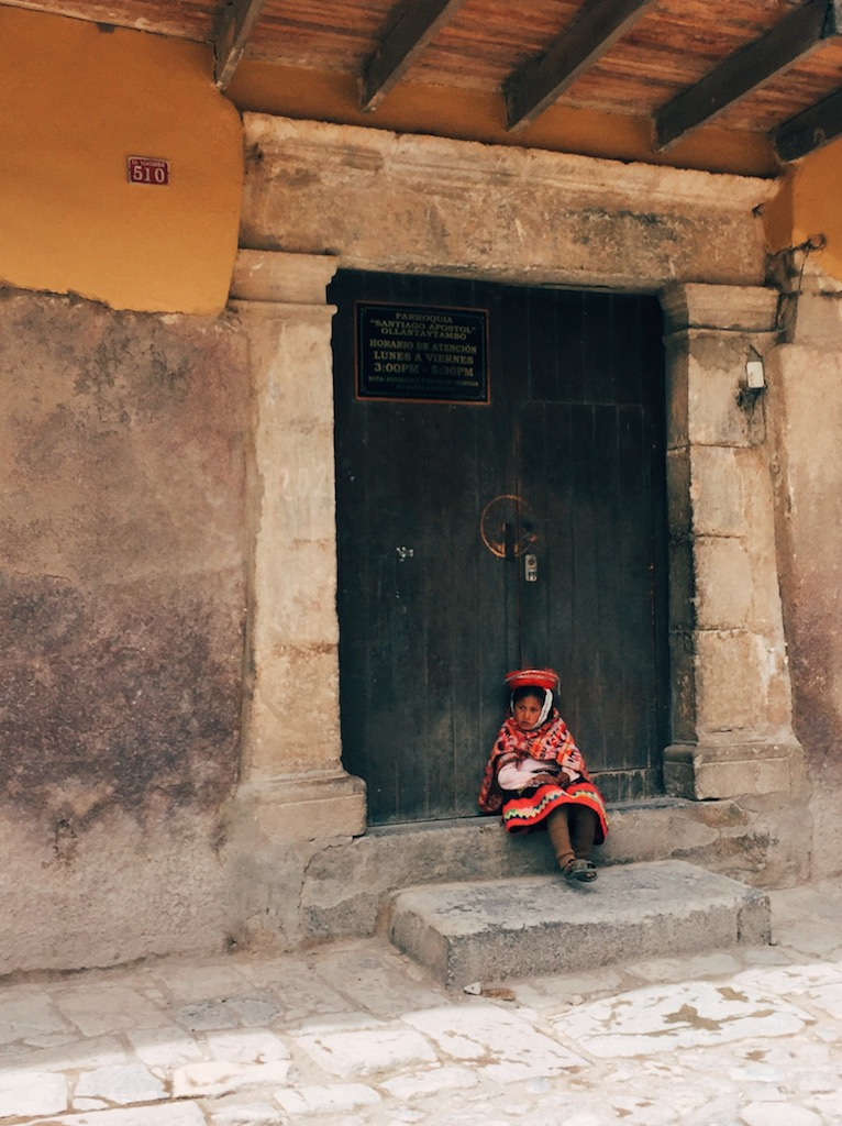 A young resident in traditional costume, Ollantaytambo.
