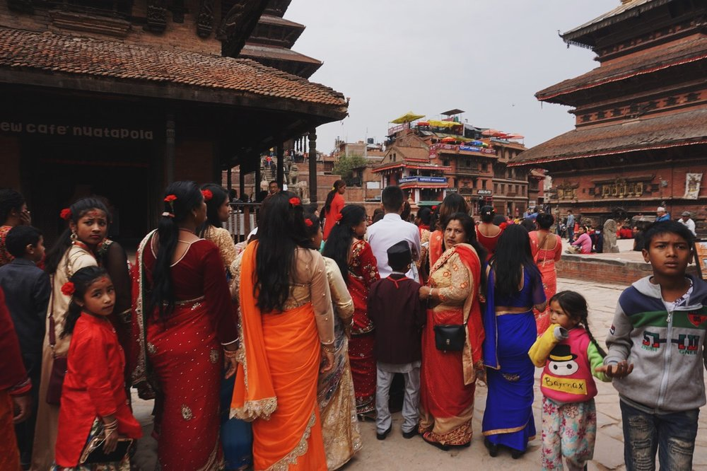 A wedding procession in Durbar Square. Women and girls walked separately from the men and boys,