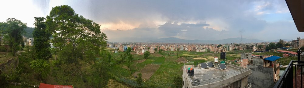 View from the lovely Bhaktapur Paradise Hotel, looking over fields and into the center of Bhaktapur, Kathmandu Valley