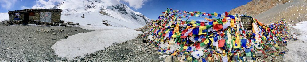 Innumerable prayer flags decorating Thorung La Pass, reportedly the highest non-technical pass in the world (17,769 ft / 5,416 m)