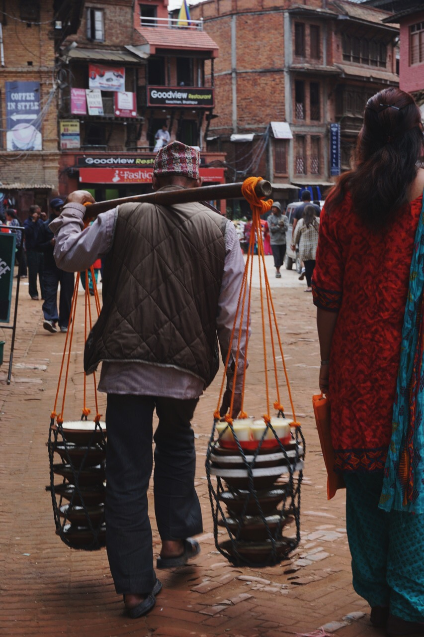 A man selling 'king curd,'Bhaktapur's culinary specialty made of sweet buffalo milk, cloves, cardamom, and coconut