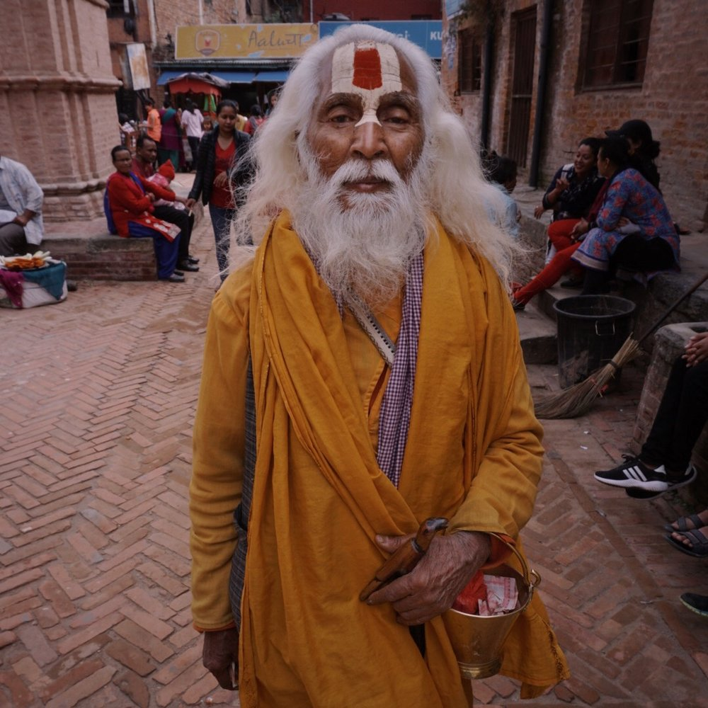 This is Dass, an ascetic sadhu. Sadhus are holy men who have renounced their worldly lives and are traveling hundreds if not thousands of kilometers from India with next to nothing on their backs.