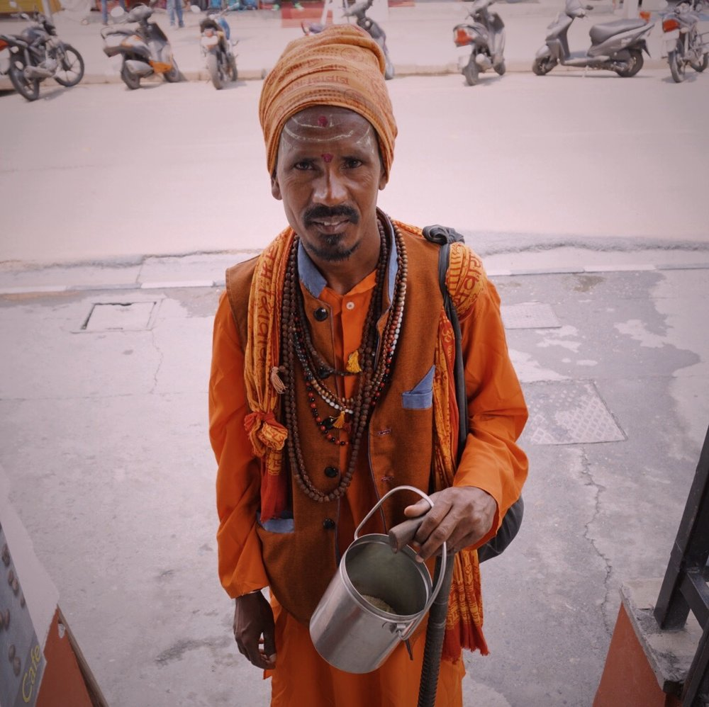 An ascetic Sadhu. In exchange for a hearty namaste and a donation toward his pilgrimage, he permitted me to take his portrait.