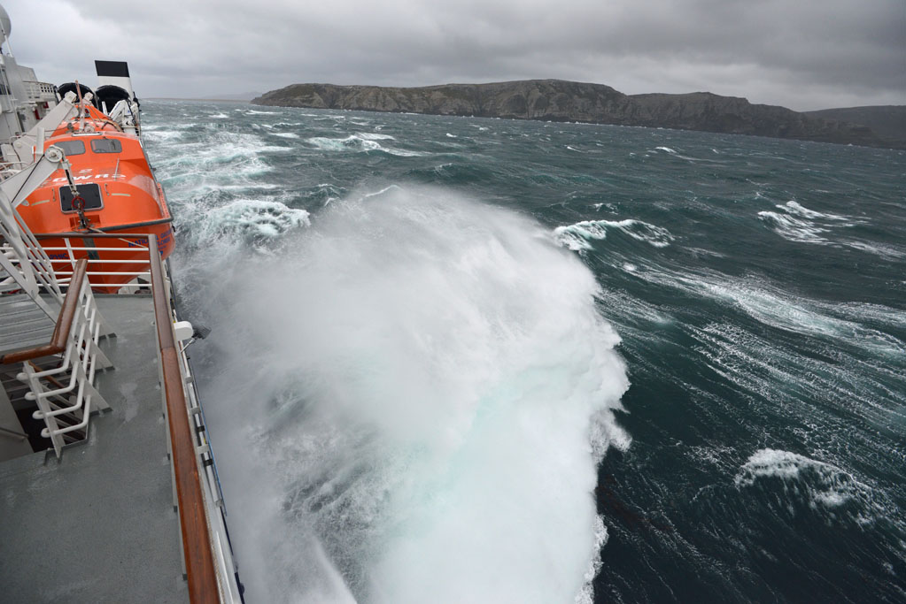 Waves battering against the side of our ship