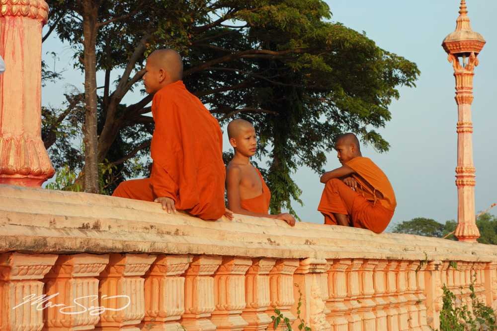 Monks resting near a small temple