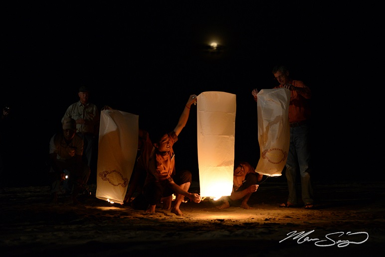 Floating lantern beach party for the guests on our last night. Full moon rising in the background.