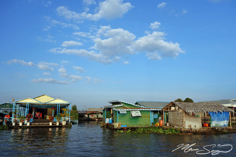 Floating village near Chau Doc, Vietnam. These people live in their floating houses year round. In some of the larger floating villages, they even have buildings for gas stations, schools, salons, etc... it's really interesting taking a boat through and seeing how these people live on the water!