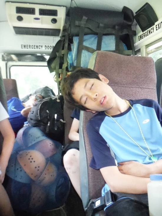 Exhausted on the bus after a full morning exploring Island Ford Cave.