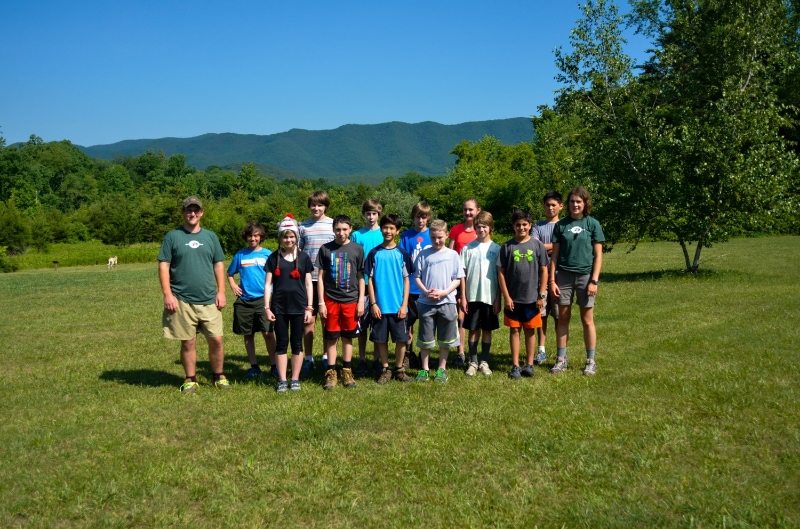 Day 1: Group A, Lead by Charlotte & Jay, stand together in front of the Price Ridge Mountains on Base Camp.