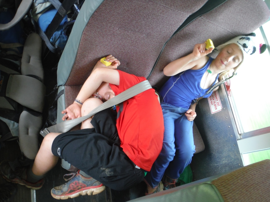 Kids being silly, getting ready to get off the bus!
