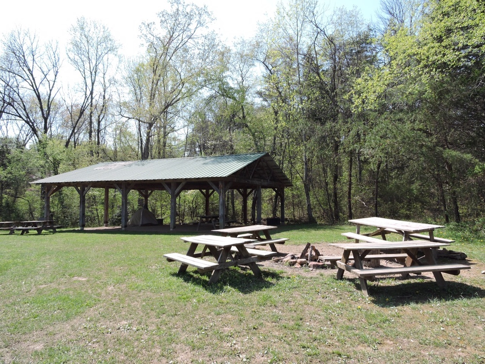 Accessible by a separate entrance to our property, is our largest campsite.  It is equipped with a pavilion, large fire ring, camp grill, picnic table, and Port-a-Potties during the summer season.  There is about a ten minute walk to the bathhouse, water pump, and the free Base Camp activities.   Nightly Fee: $50 plus $10 per person.