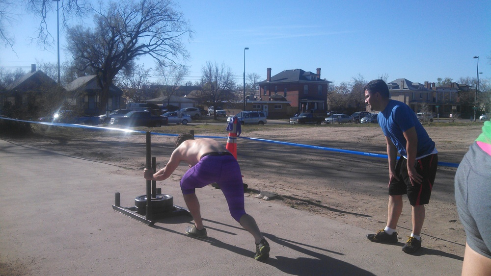 Coach Jeff pushing that gnarly sled that comes in at ~145#. It may not seem that much, but over that pavement, you migth as well push into a brick wall.