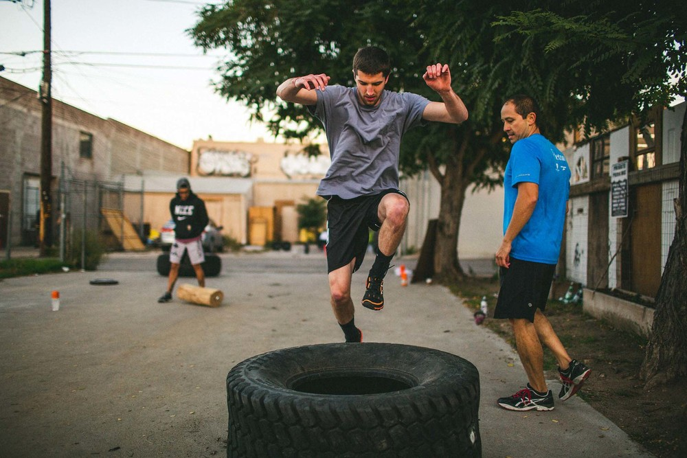 Tommy getting after tire flips and jumps over the tire during a Friday Night Lights class.