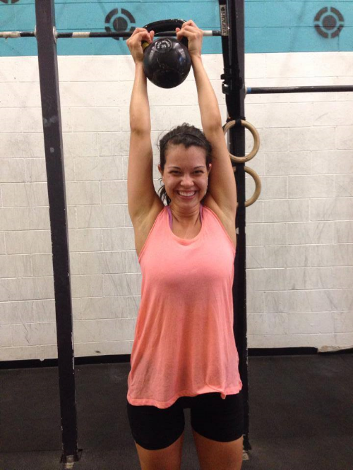 Desiree celebrating after completing her first WOD with a 35# Kettlebell on July 19th!