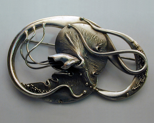Fluid, organic, free-form brooch.