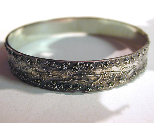 Handcrafted free-form bangle.