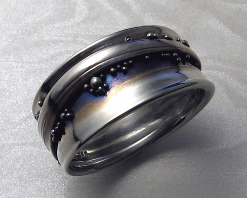 Fluid, organic, free-form, handcrafted wrap-a-round band with granulation.