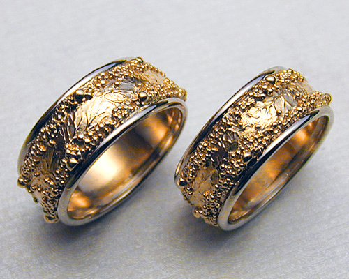 Wedding rings with spherical granulation and branch like textures.
