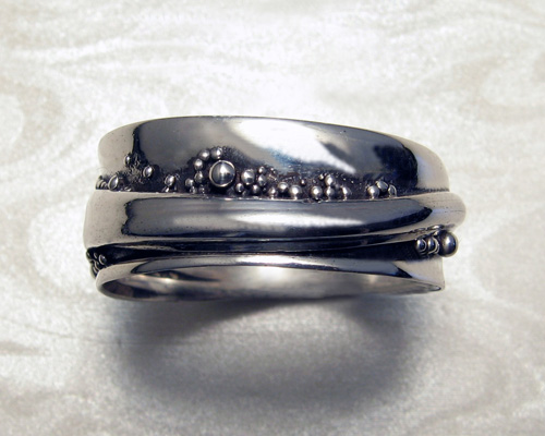 Wrap-a-round wedding ring with granulation.