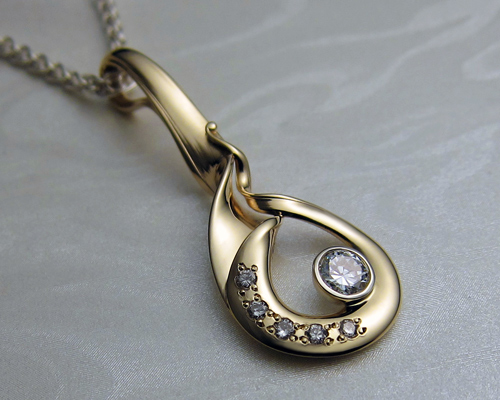 Fluid, organic, free-form drop pendant with diamonds.