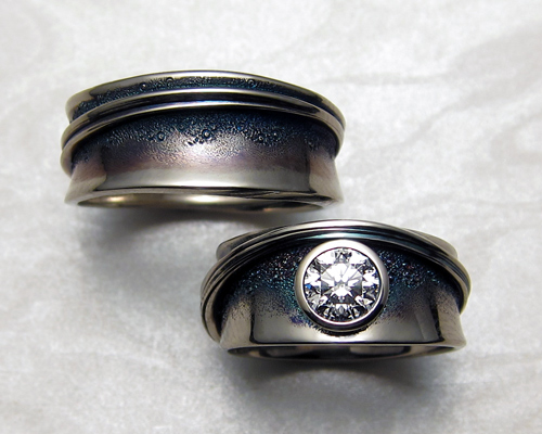 Band style engagement ring with matching gents wedding band.