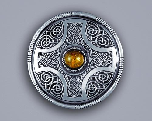 Amber, shield brooch pin.