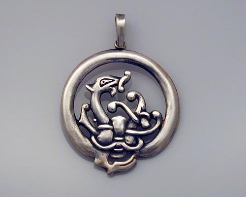 Round, Norse dragon pendant.