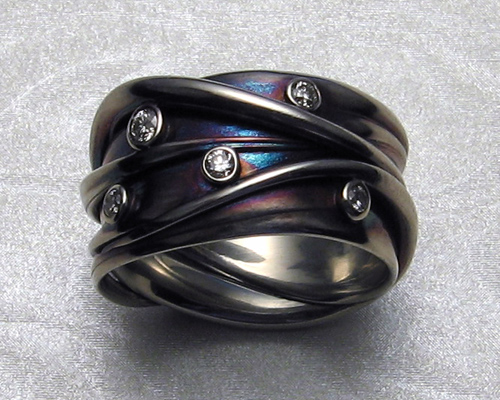 Interwoven, multiple strand, freeform wedding ring. ring.