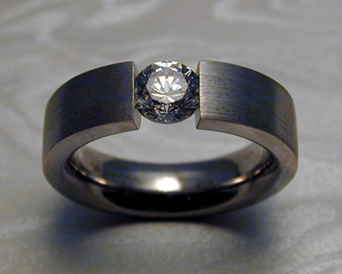 Engagement ring with tension set diamond.